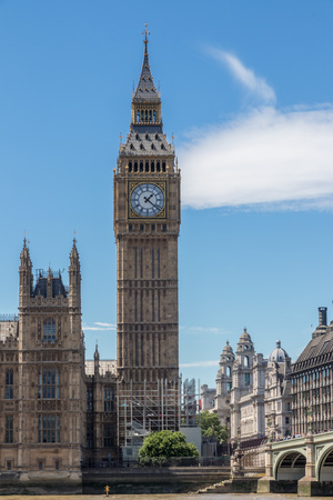 HDR image of world famous Big Ben clock tower next to Westminster Bridge in bright sunlight