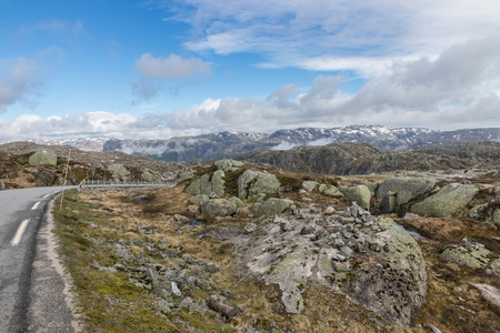 Barren granite rock landscape along world famous Kjerag mountain, a popular hike among tourists in Rogaland, Norway