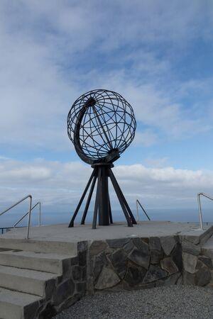 World famous globe sculpture at Norwegian North Cape, under a rare blue sky Standard-Bild