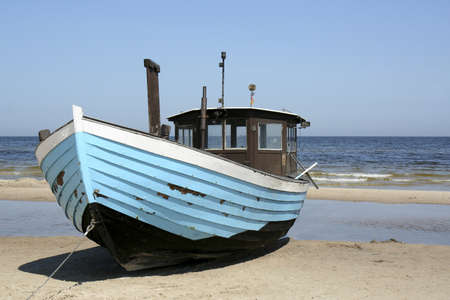 fishing boat on the baltic sea beach in usedom
