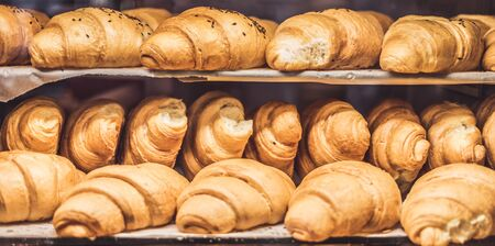 Croissants on a showcase in a bakery shop