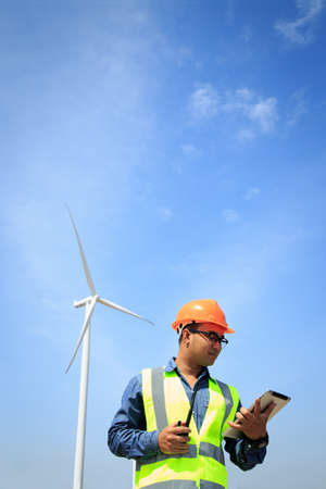 construction project: Engineers working on wind turbines.