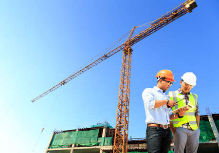 buildingsite: Engineers and construction sites and crane.