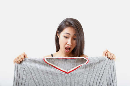 Clothes are too big for women. Stock Photo