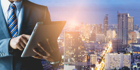 Businessmen with business investment in big cities Stock Photo