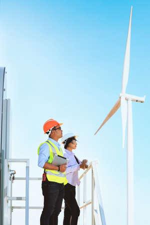 Male engineer and female engineer Working at turbine. Archivio Fotografico