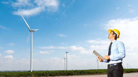 Engineers are investigating the wind turbine.