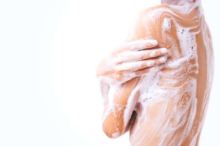 A woman is taking a shower.