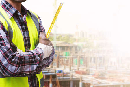 Construction site and male engineer. Stock Photo