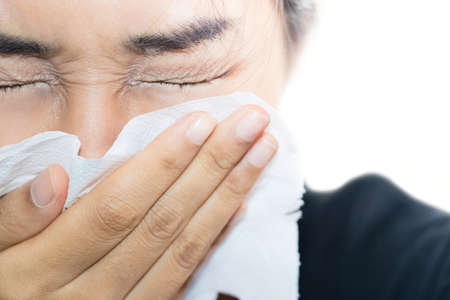 A woman is have the sniffles.