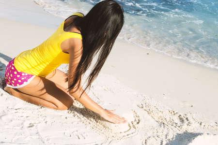 A women is enjoying at the beach.