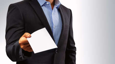 Management submits an envelope to employees.