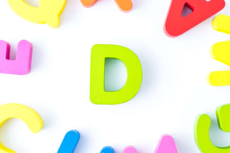 D letters in English made from wood bright colors.
