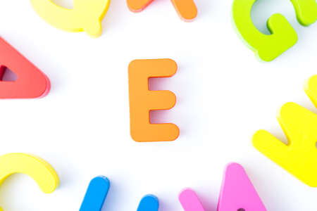 E letters in English made from wood bright colors. Stock Photo