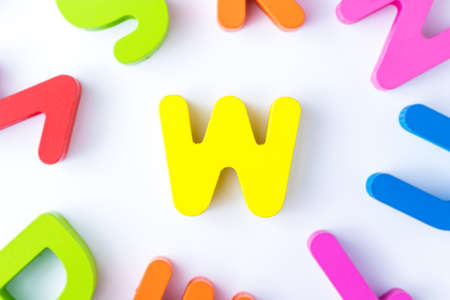 W letters in English made from wood bright colors.