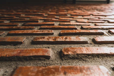 The construction wall is decorated with red brick. Stok Fotoğraf