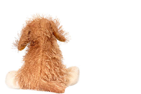 Brown dog doll, soft hair on white background.