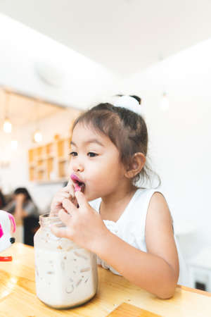 Asian little girl Drinking happy cocoa happily.
