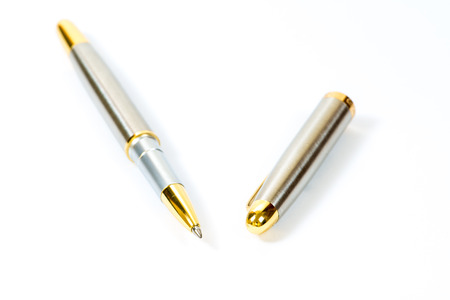 ball pens stationery: Silver ballpoint pen isolated on the white
