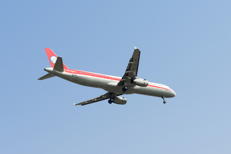 SHANGHAI, CHINA, April 2, 2015: Sichuan Airlines A321 flying in the sky.