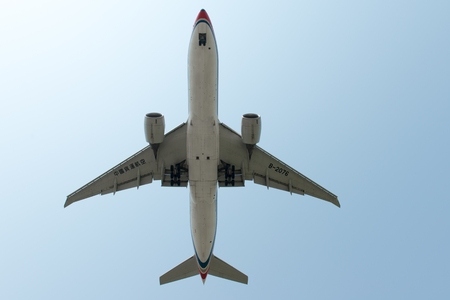 SHANGHAI, CHINA, April  2015:China Cargo Airlines  Boeing 777 B-2076 flying in the sky.