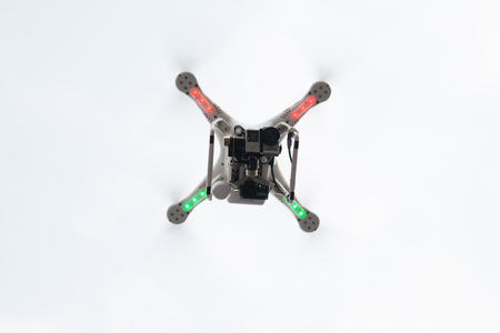 spying: SHANGHAI,CHINA-April 30,2015:Flying drone quadcopter Dji Phantom 2 with digital camera GoPro HERO4.