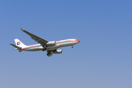 SHANGHAI, CHINA, April 2 2015:China Eastern Airlines  A321 flying in the sky.