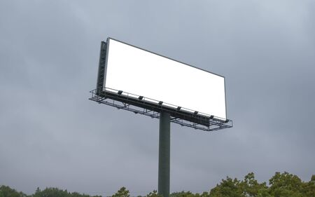 Blank billboard with empty screen on cloudy sky background Stock Photo