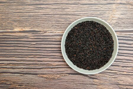 a plate of black rice on  the table