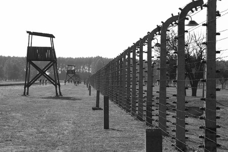 A fence and guard tower at the death camp Auschwitz, Poland.