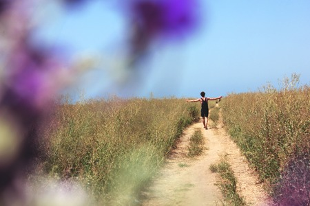 man goes into the distance in the field Stock Photo