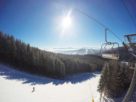 chairlift: view from chairlift on slopes of ski resort