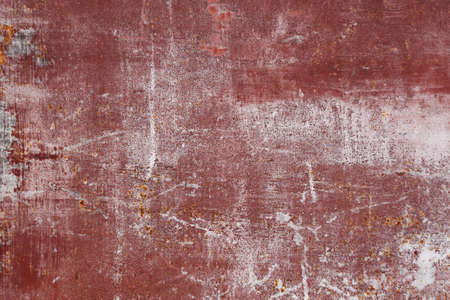 scratched: red scratched metal surface with peeling paint