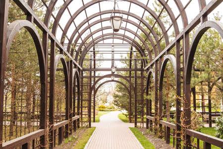 archway: big luxury dark wooden archway in garden
