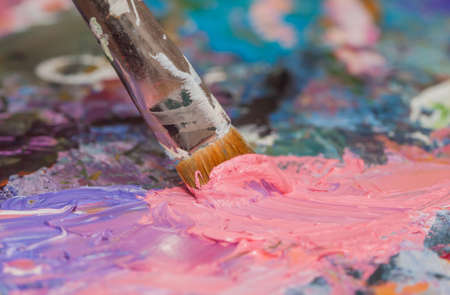 vibrant paintbrush: oil paints and brushes can be used as background Stock Photo