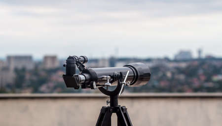 an eyepiece: telescope on the roof as personal observation point