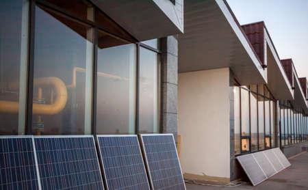 buiding: solar panels on balcony of modern office buiding