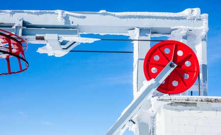 Ski lift red wheel elements on blue sky background Banco de Imagens - 53679027