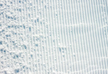 even: white even prepared surface of ski slope as background