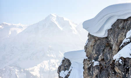 overwhelming: Winter mountain top with big snow cap as backgorund Stock Photo