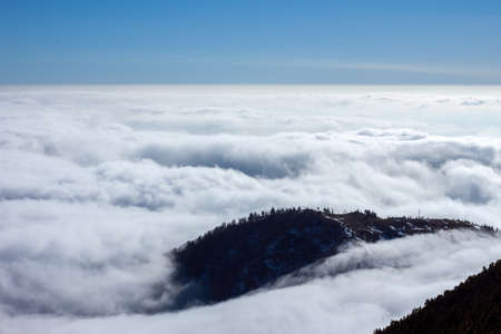 soft peak: View on mountains and blue sky above clouds Stock Photo