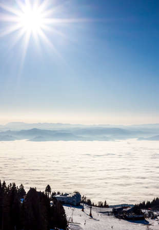 soft peak: View on sun and mountains blue sky above clouds Stock Photo