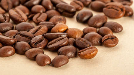 golden bean: coffee beans on the paper can be used as background Stock Photo