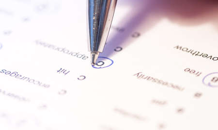 test paper: language test paper with circled answers as background Stock Photo
