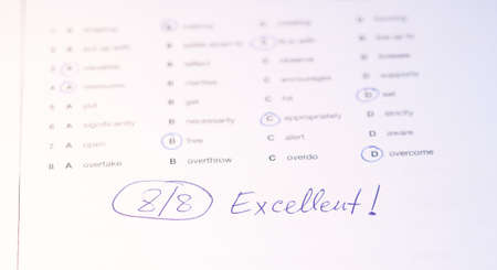 school exam: language test paper with circled answers as background Stock Photo