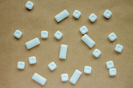 gums: mint sweets and chewing gums against the craft background