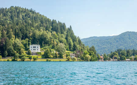luxury house: luxury white house in forest on lake Bled shore