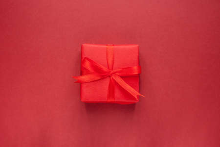 bow knot: gift box with bow knot on red craft background