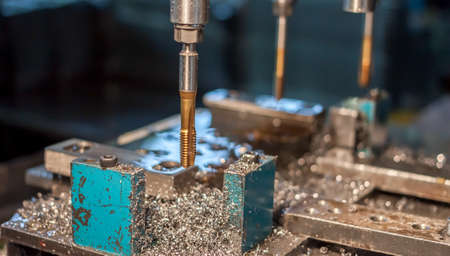 tapping: metal drilling and tapping Stock Photo