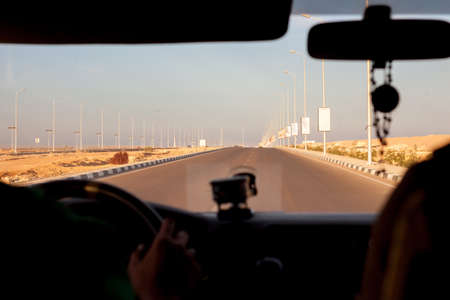 road and path through: view through windshield in Egypt